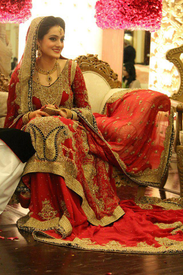 Red plus golden Bridal Lehenga with long tail