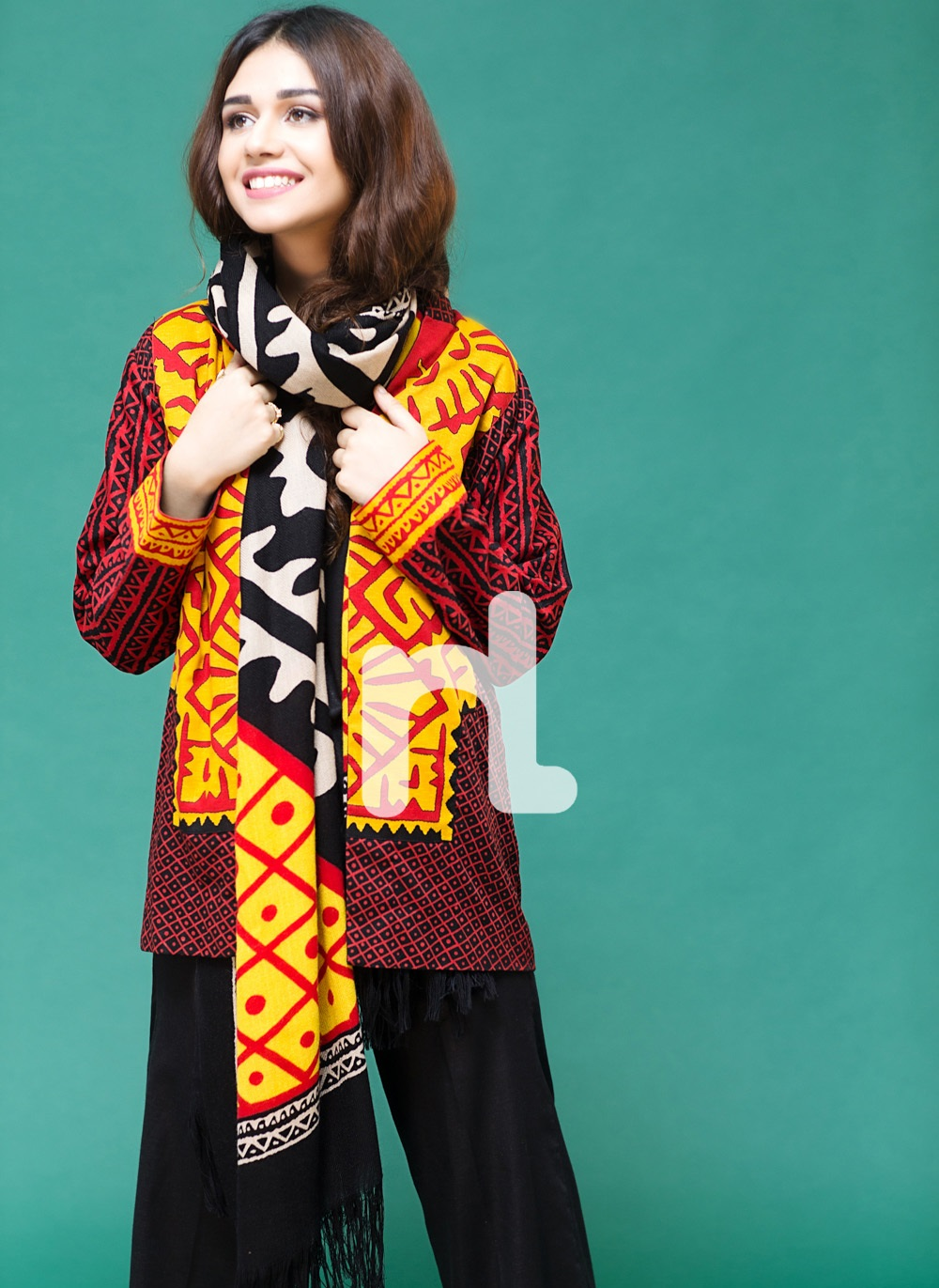 bright black and red winter suit by Nishat