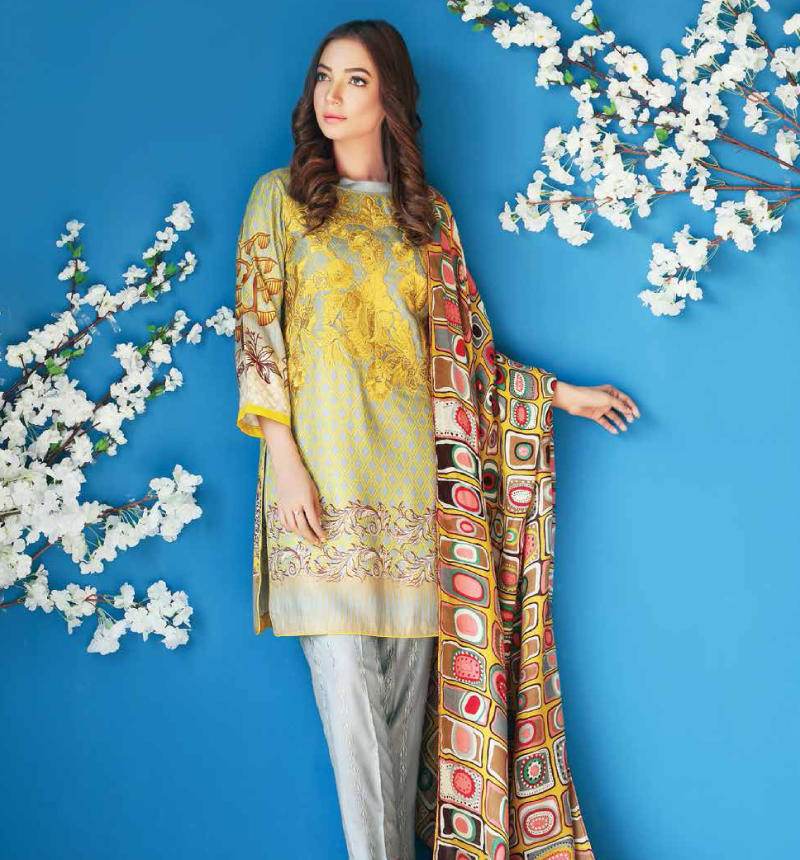 grey twill shirt with yellow embroidery on neckline and printed pashmina shawl.