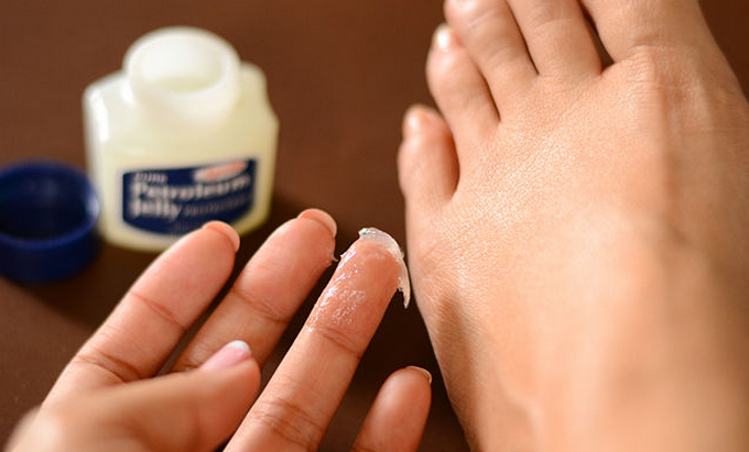 applying vaseline on feet nails