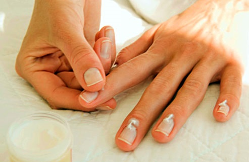 applying soothing lotion on nails