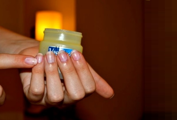 applying vaseline on nails of hands