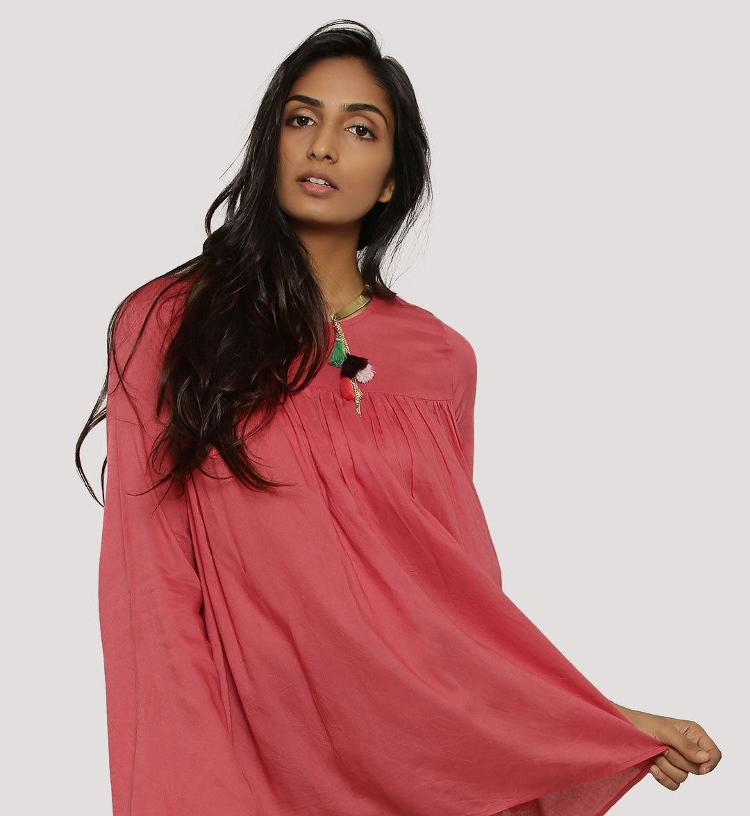 koovs Trapeze pink volume winter top for women