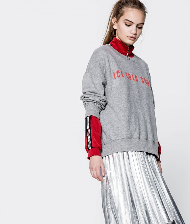 grey sweatshirt with red print and a panel skirt