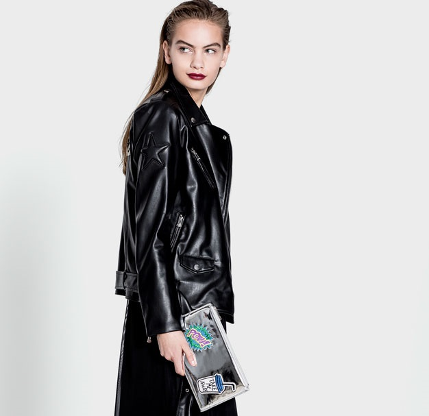 pull and bear black net dress with leather jacket on the top