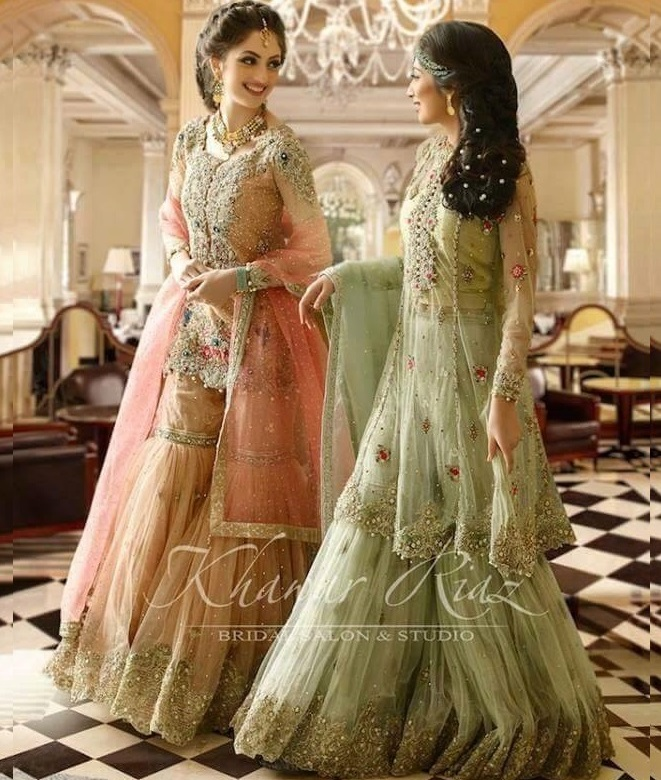 Pink and green embroidered net shararas with short and medium length shirts