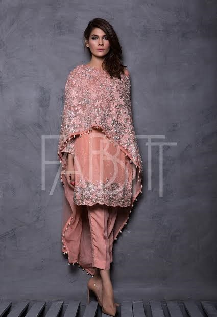 heavily silver embroidered pink cape with plane suit