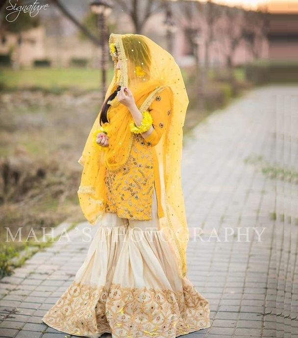 pretty yellow mehndi bridal suit with sharara