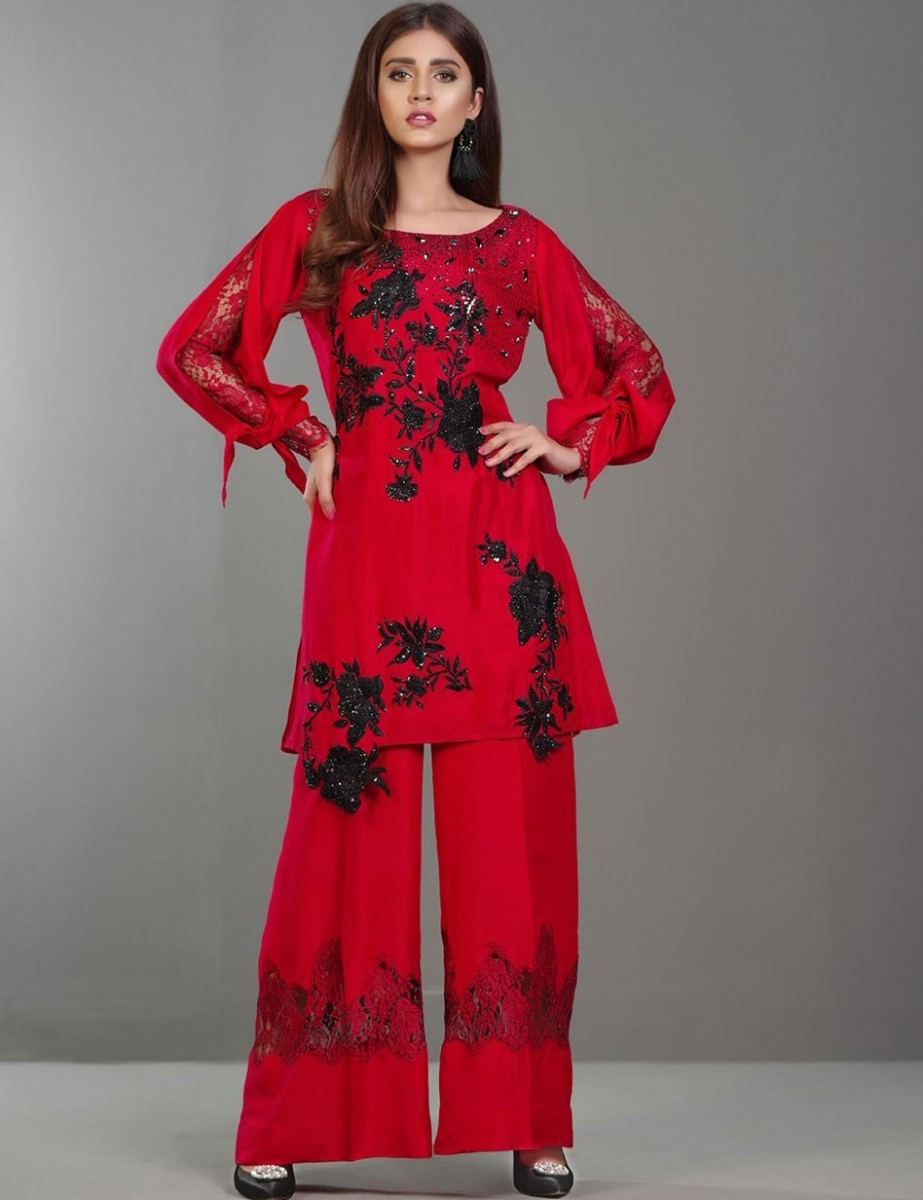 Red embroidered Eid dress with Swarovski crystals and Chantilly lace trousers by Zainab Chottani