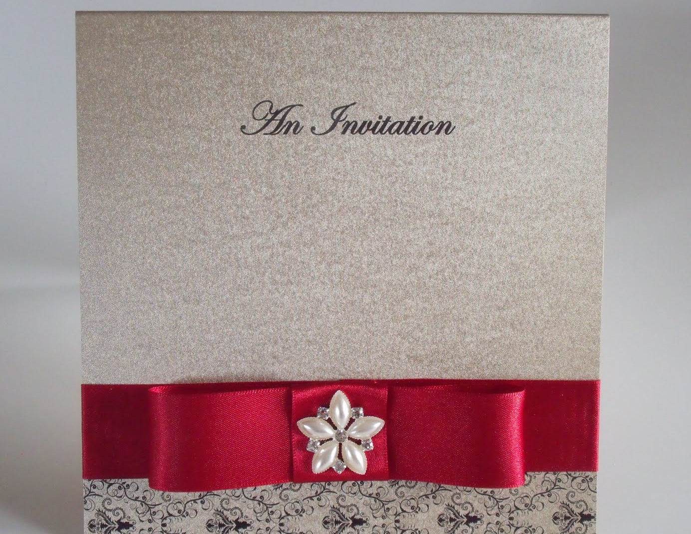 Silver wedding card with cherry red colored ribbon
