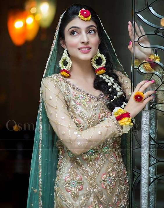 Mehndi bride wearing Floral Jewelry