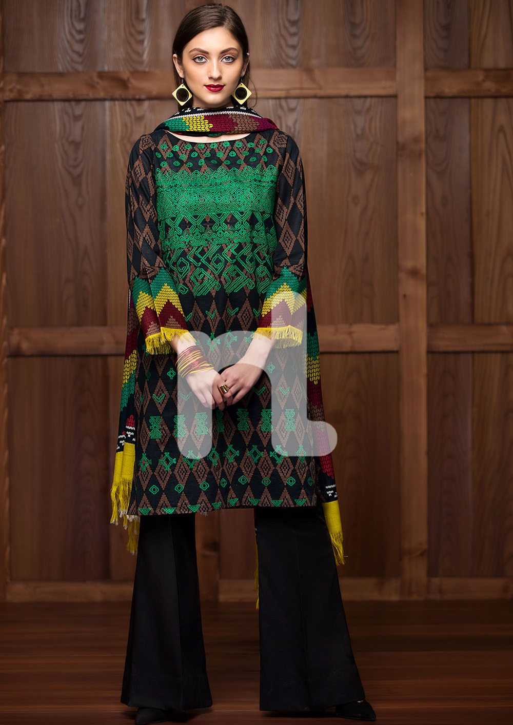 Bold geometric printed black winter dress with green embroidery