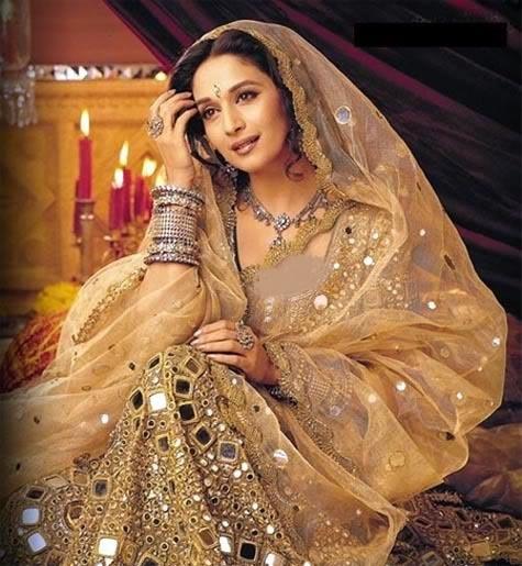 Madhuri Dixit in Skin mirror work bridal dress
