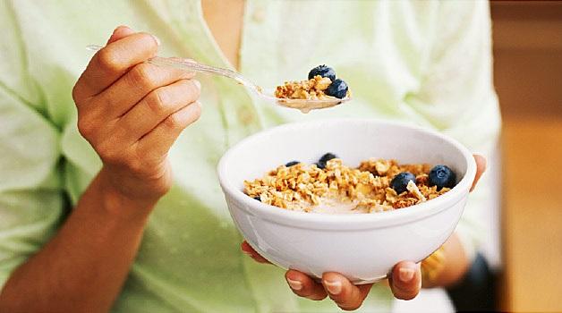 woman eating granola
