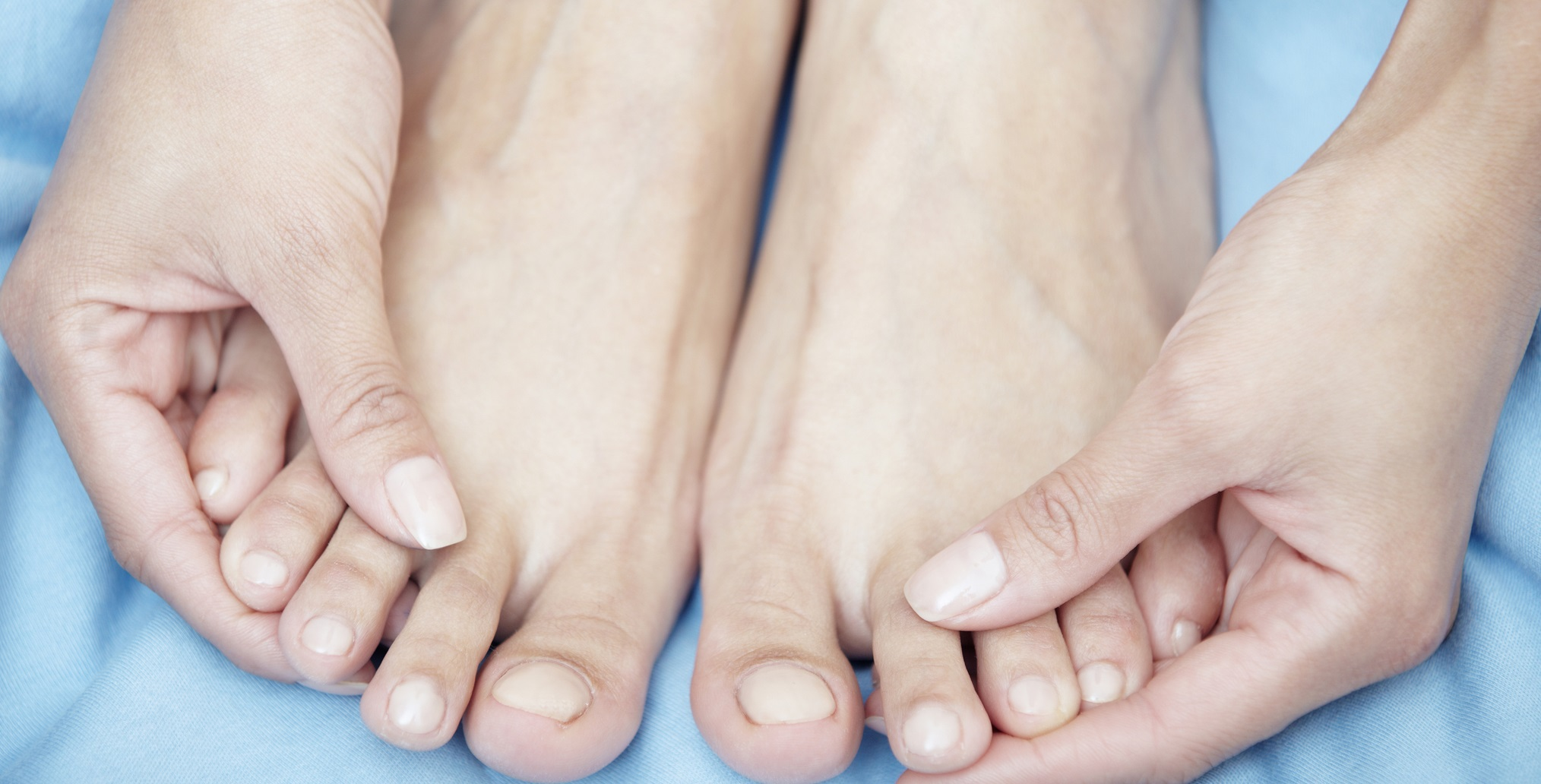 applying soothing oil on feet and nails