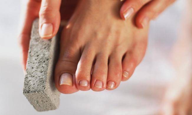 scrubbing feet with a scrubber