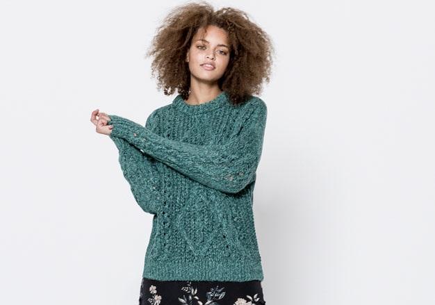 green pattern woollen sweater with black skirt