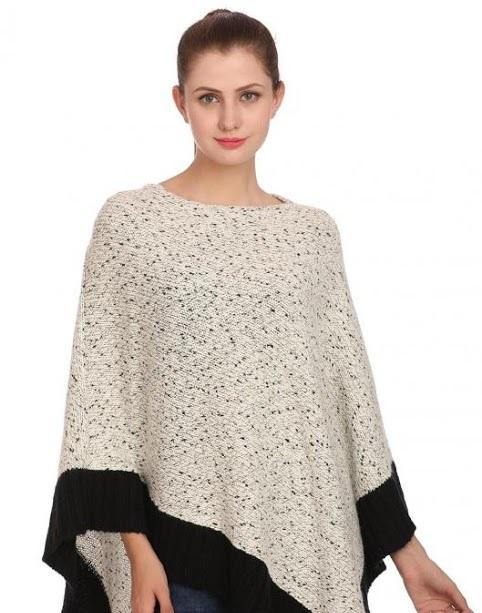 Madame White knit style poncho with black border