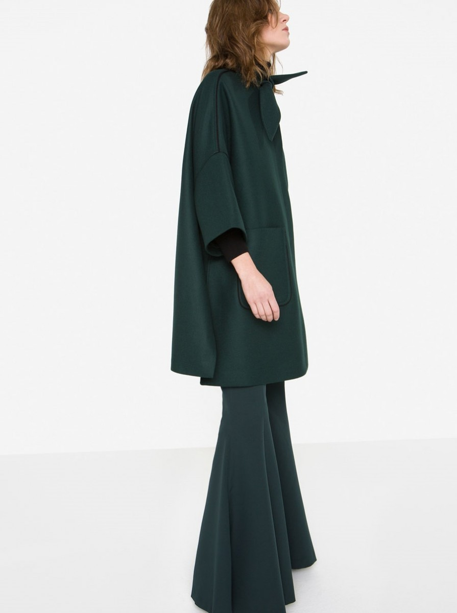 Uterque wool winter cape with bow and bell bottom trouser