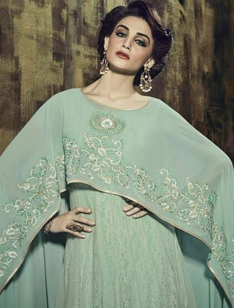 light green cape dress with embroidery on sleeves