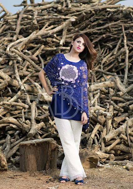 blue cape style short top with white bell bottom trouser