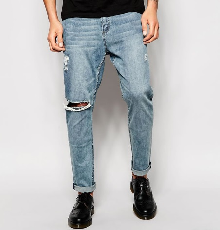 Ripped knees and worn-looking jeans